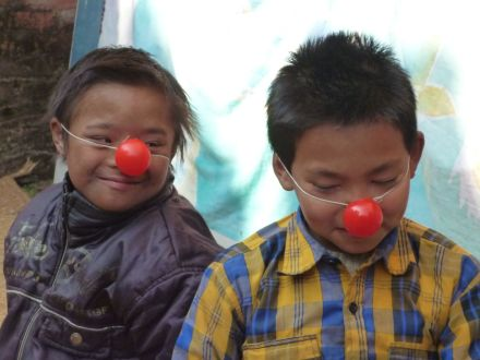 Two boys enjoying their clowning