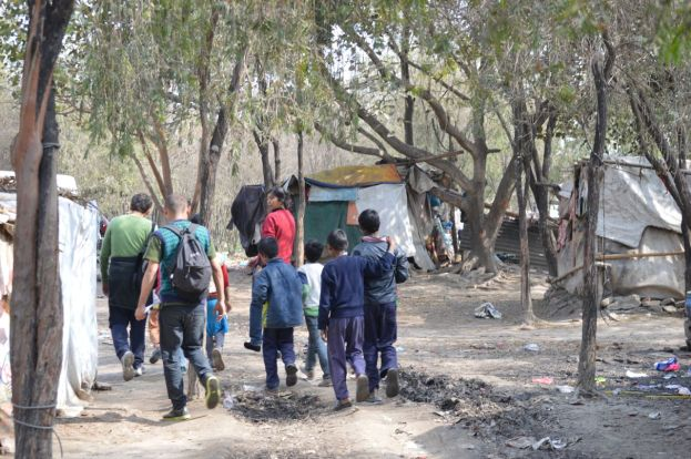 Alex walking to the School of Social Work with the children