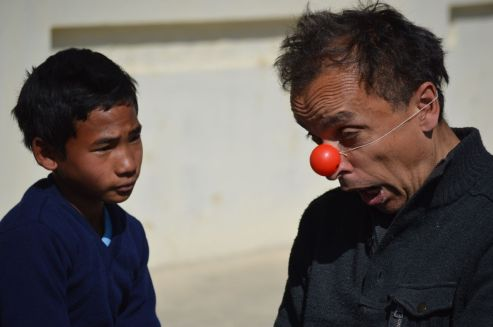 Clowning with school children in a community school in the Brick Kilns.