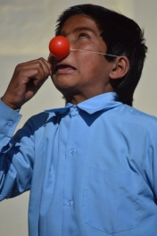 a clown in the making in the Brick Kiln community school