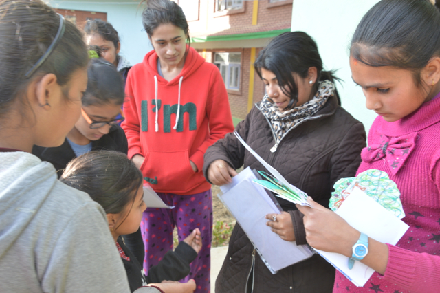 Deepa Subedi from READ hands out the letters to rural children