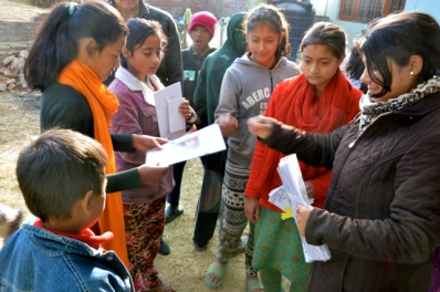 Deepa from READ handing out the letters