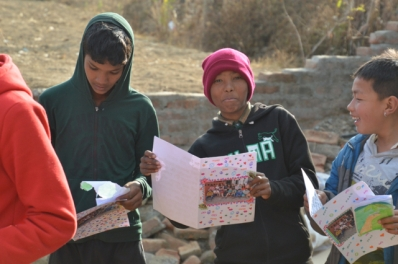 a delighted Nepali young person with his MGIS personal letter