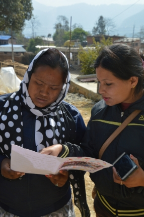 Nimala KC (from UEMS) reads the letter with a youth volunteer from Jhanuwarashi