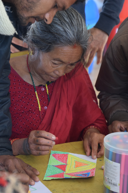This grandmother was totally engrossed in her art making.